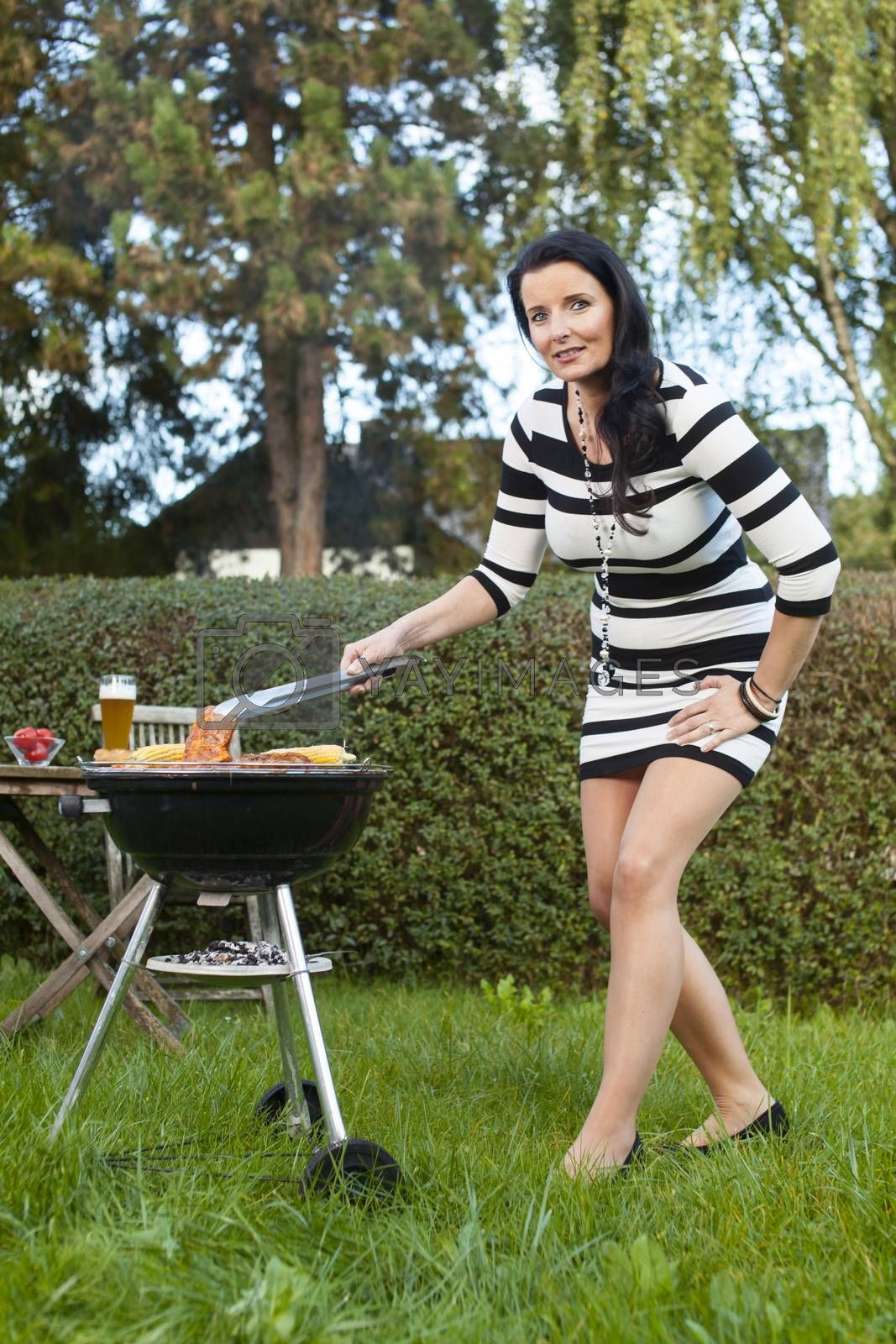 woman in the garden with a bbq