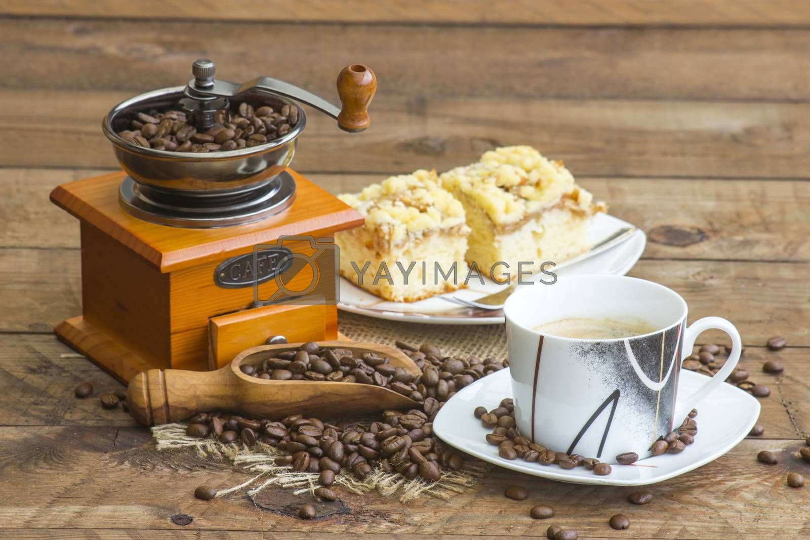 cup of coffee, apple cake and coffee grinder on wooden background