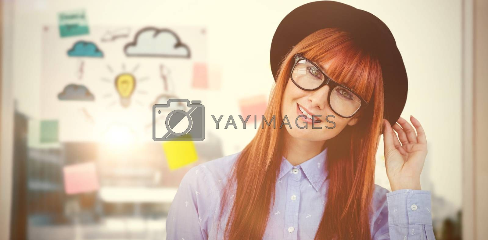 Smiling hipster woman posing face to the camera against adhesive notes on window
