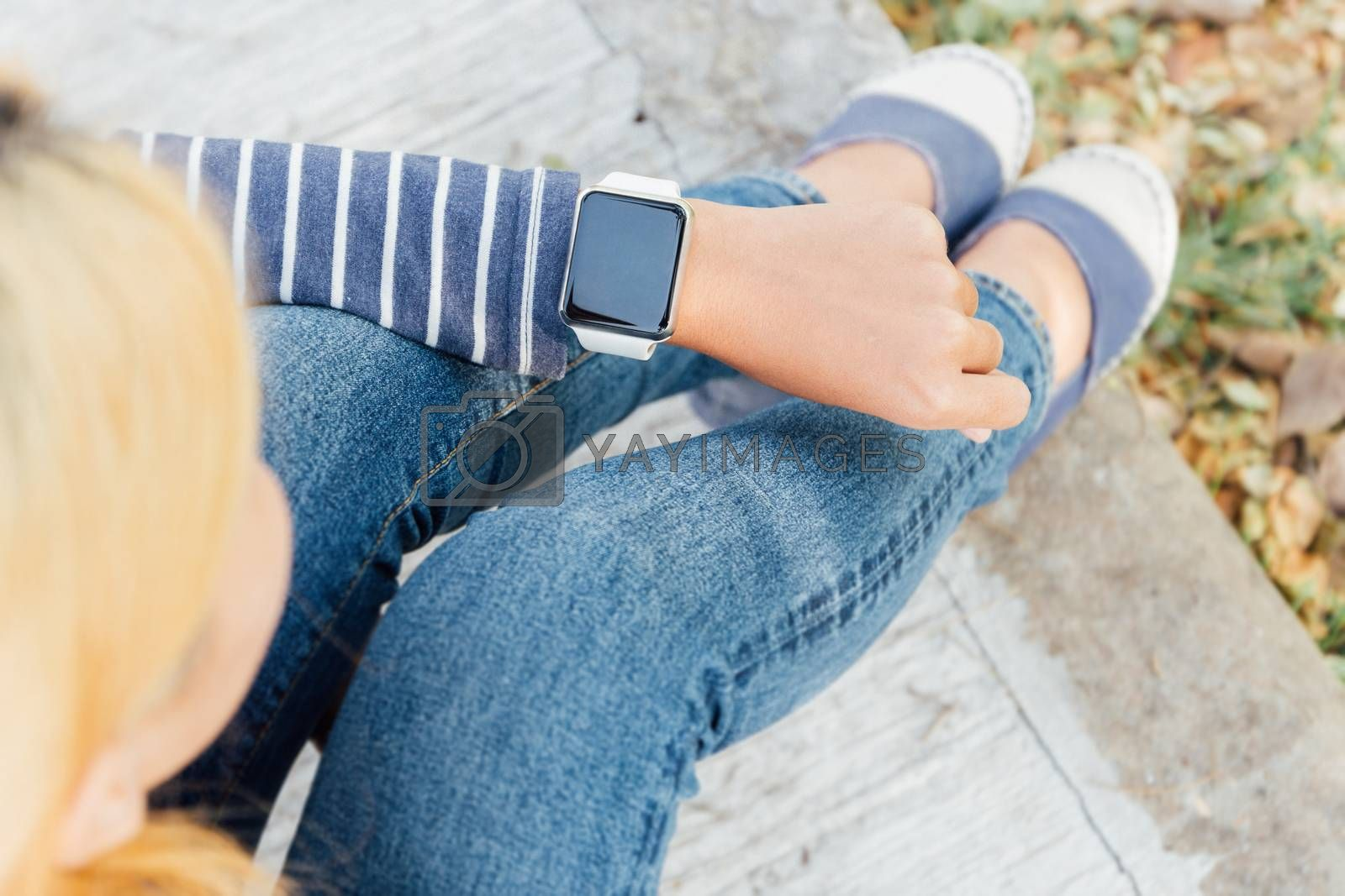 hipster woman looking smart watch new technology