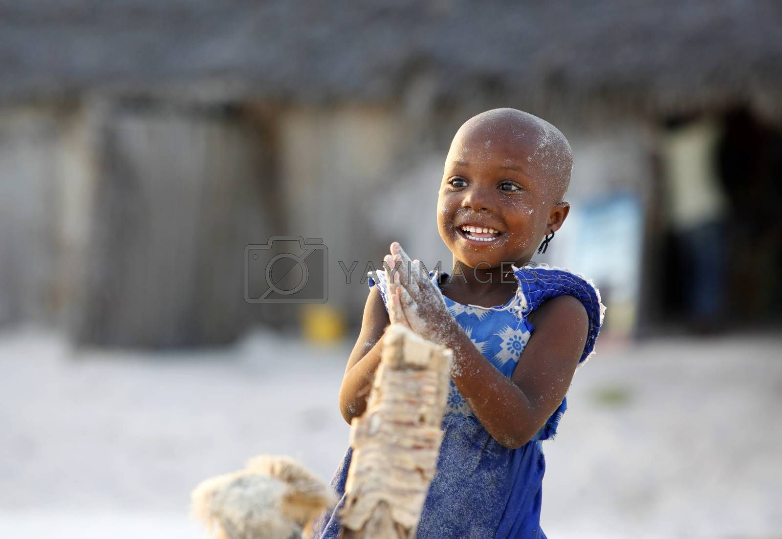 Zanzibar, Tanzania - January 9, 2016: Little cheerful African girl on the beach posing for photos Nungwi. Zanzibar