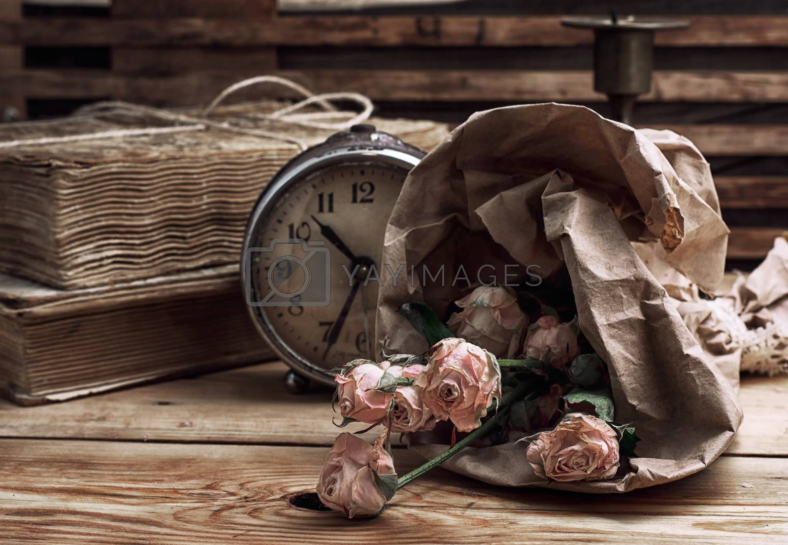 retro composition with bouquet of roses and staromodniot hours