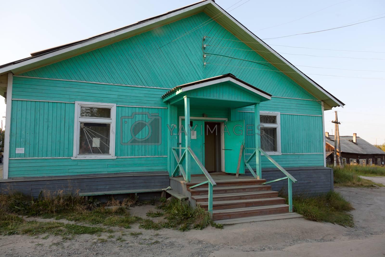 The old blue wooden shop. Umba village, Murmansk region, Russia.