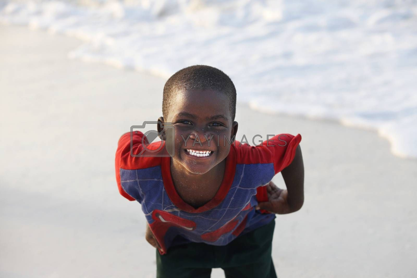 Zanzibar, Tanzania - January 9, 2016: Little cheerful African boy on the beach posing for photos Nungwi. Zanzibar