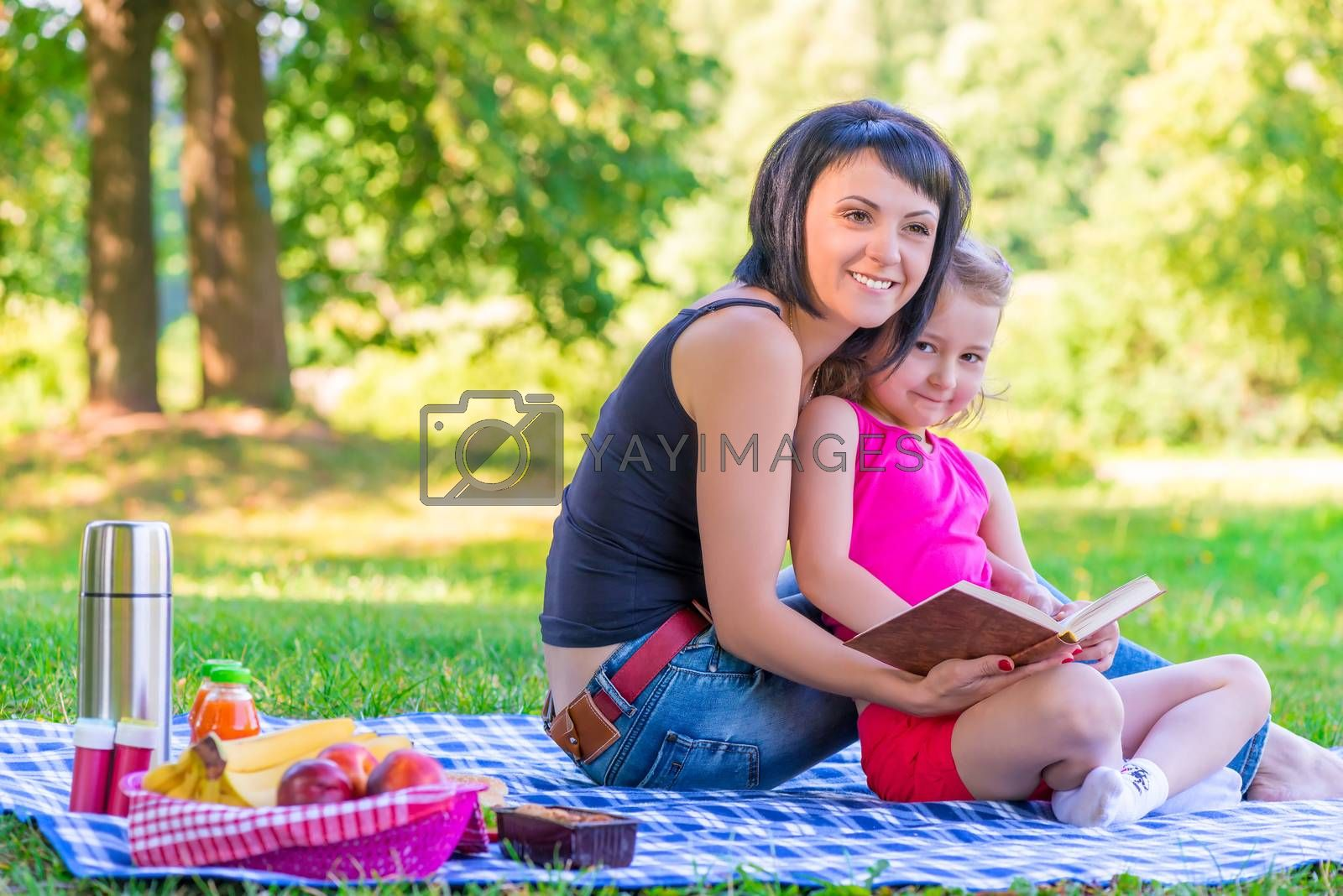young mother with her daughter at a picnic