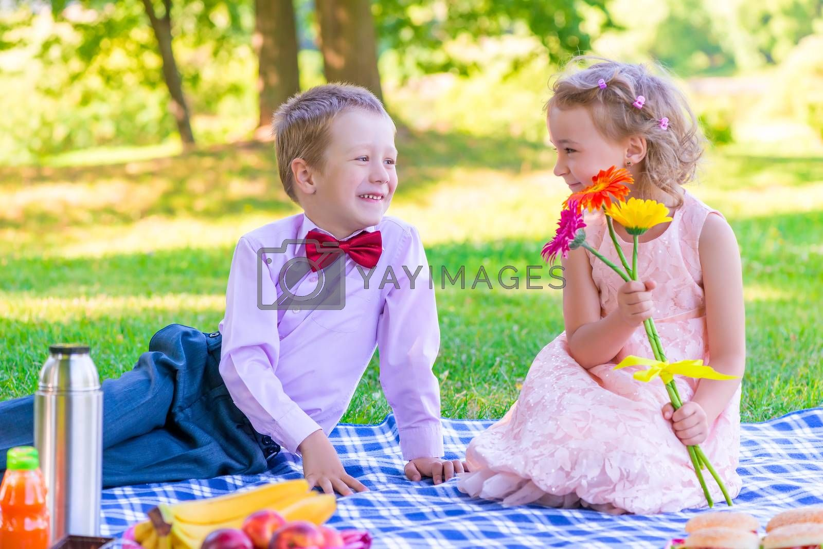 a pair of lovers of children at the picnic on the lawn