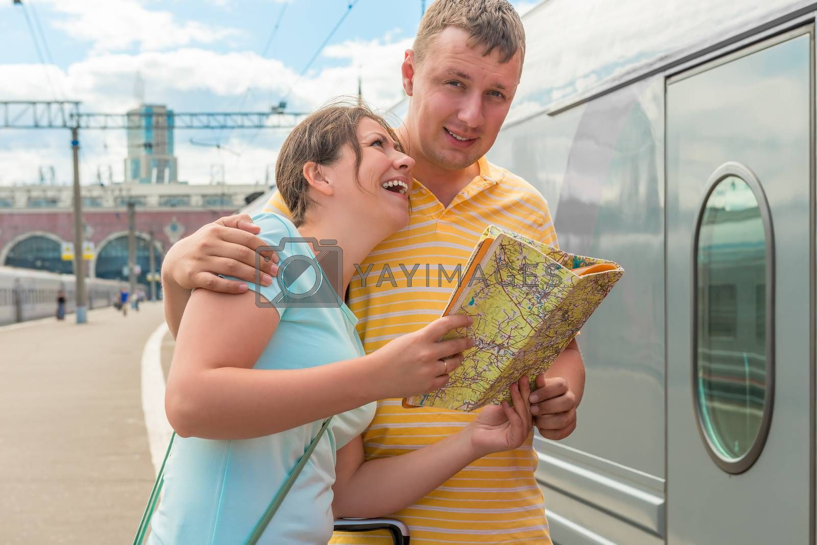 young couple with map in hand near the train at the station by kosmsos111
