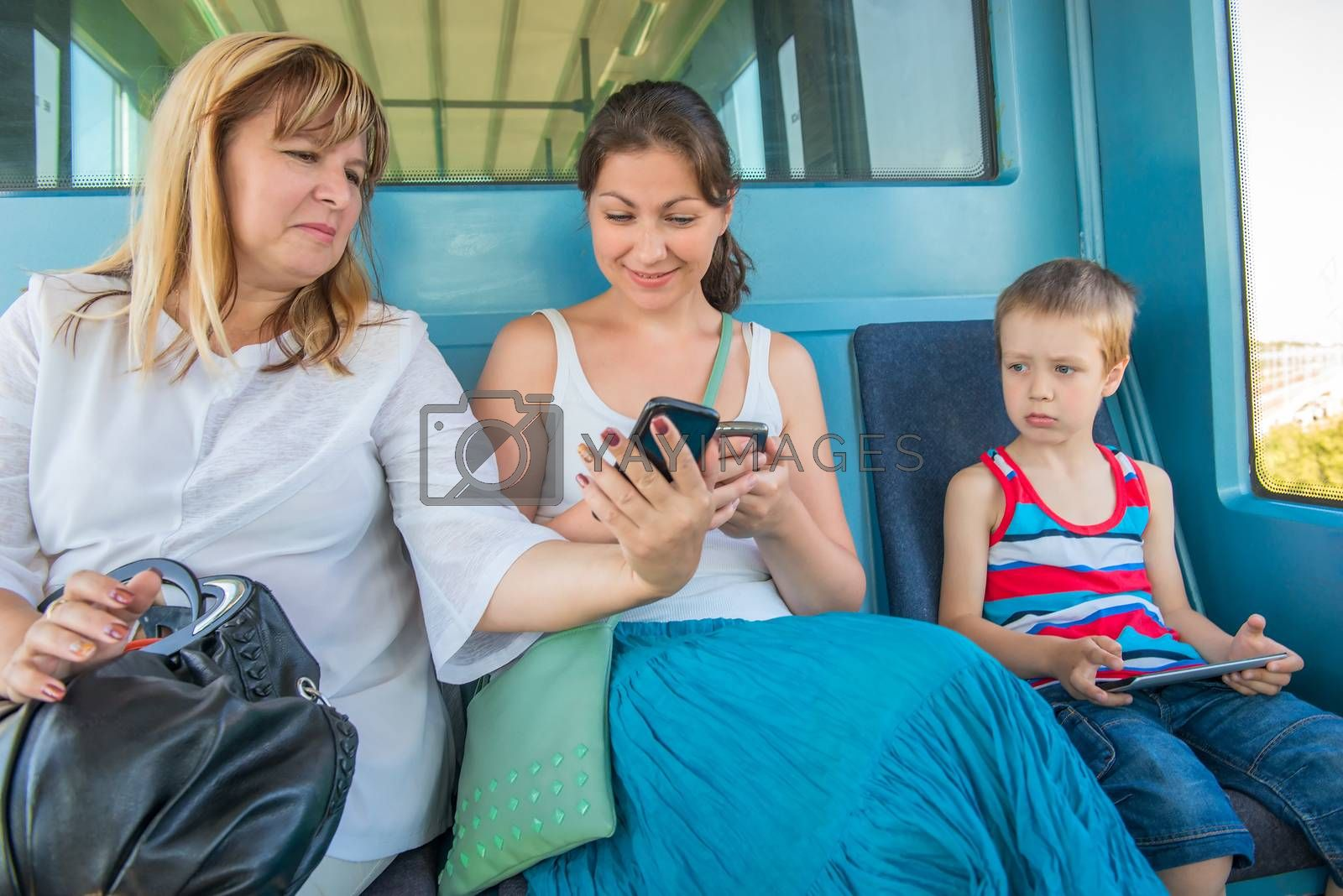 Portrait subway passengers with mobile devices