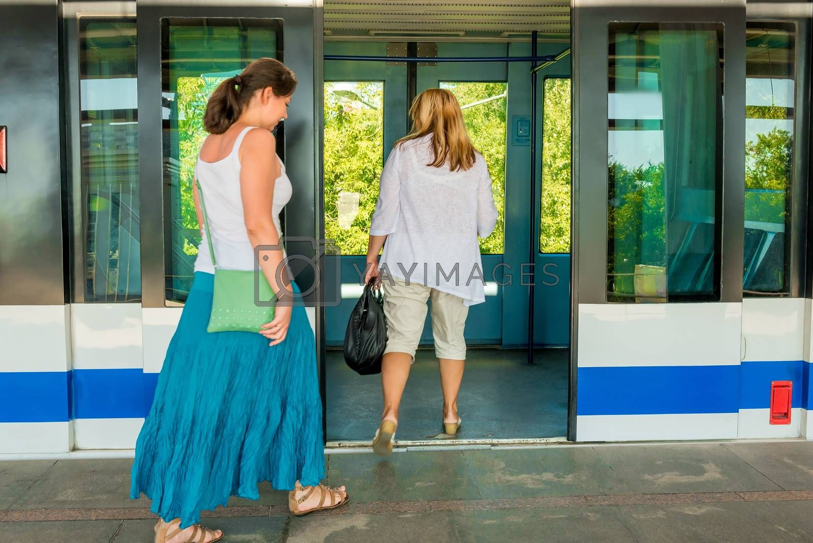Passengers enter the doors of subway train