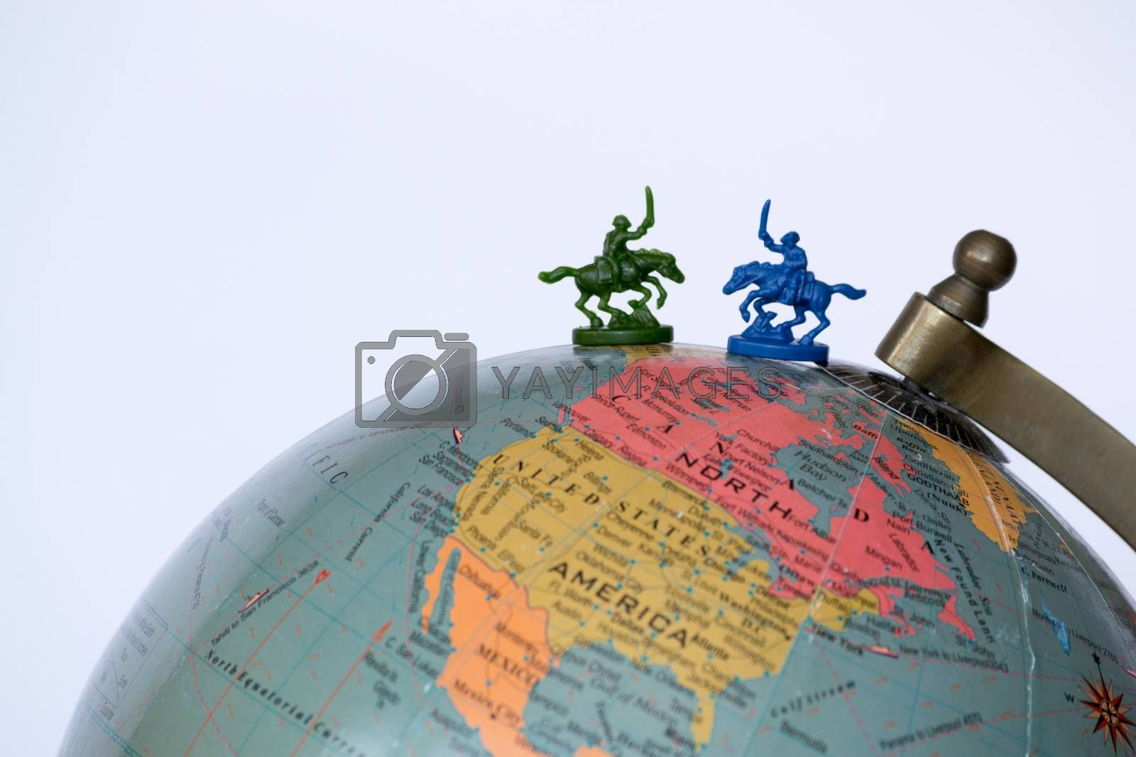 Plastic soldiers on top of a globe