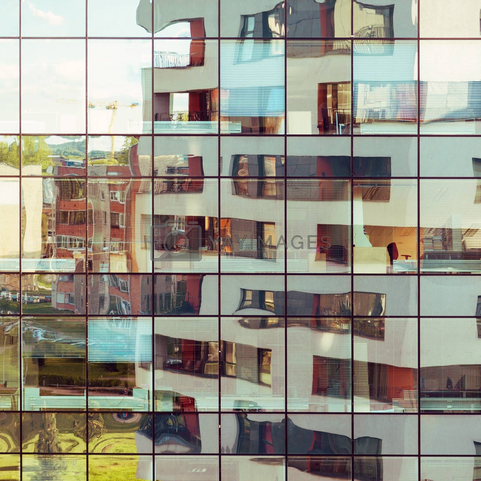Modern architecture building reflected on glass facade of another building. Abstract looking background