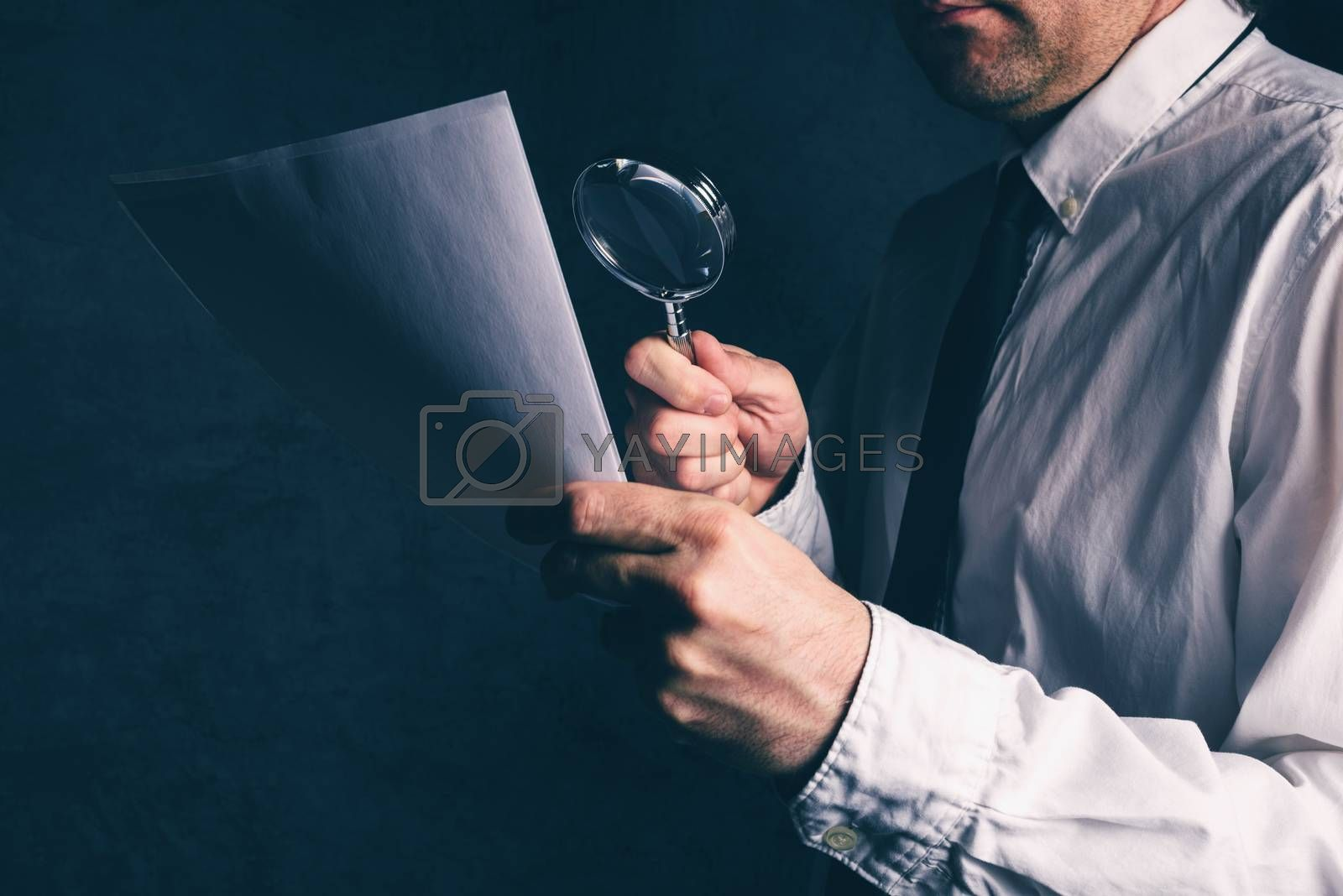 Royalty free image of Tax inspector doing financial auditing, businessman reading cont by stevanovicigor