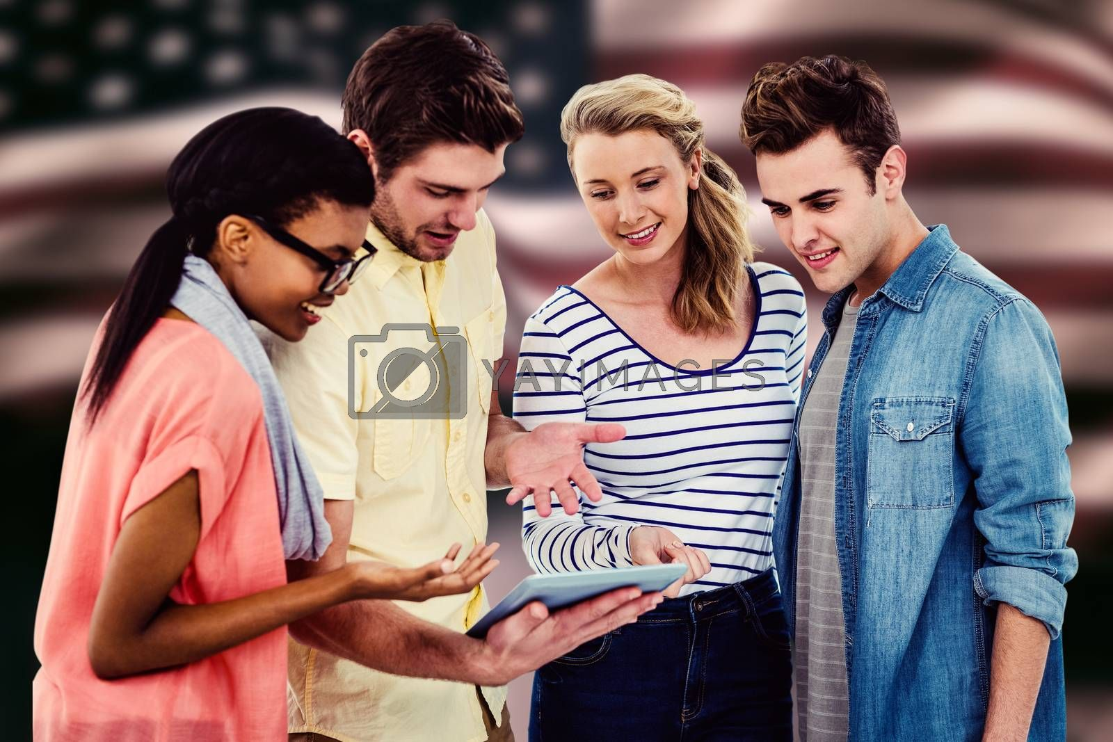 Happy creative team using a tablet pc against composite image of digitally generated united states national flag
