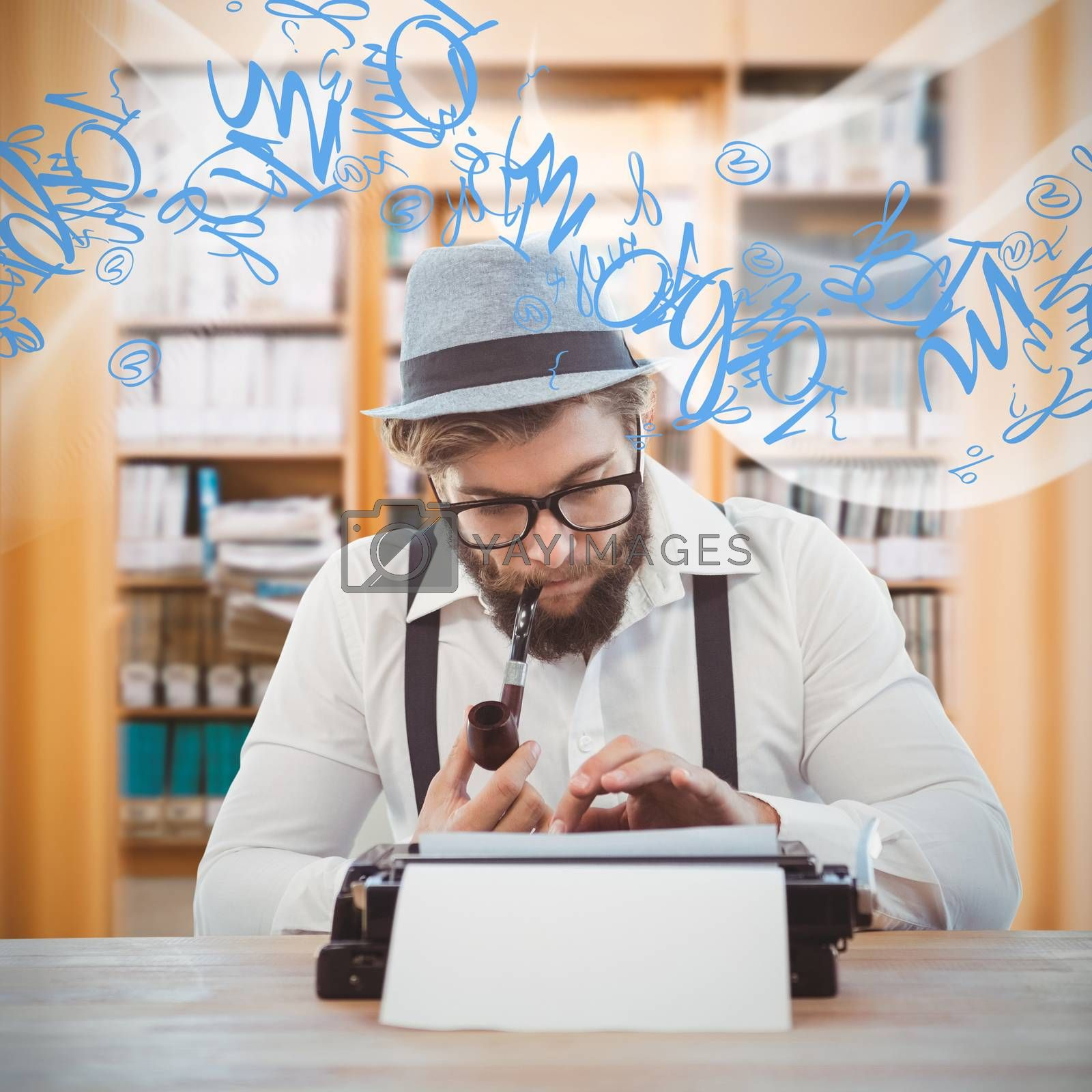 Hipster smoking pipe while working at desk against library