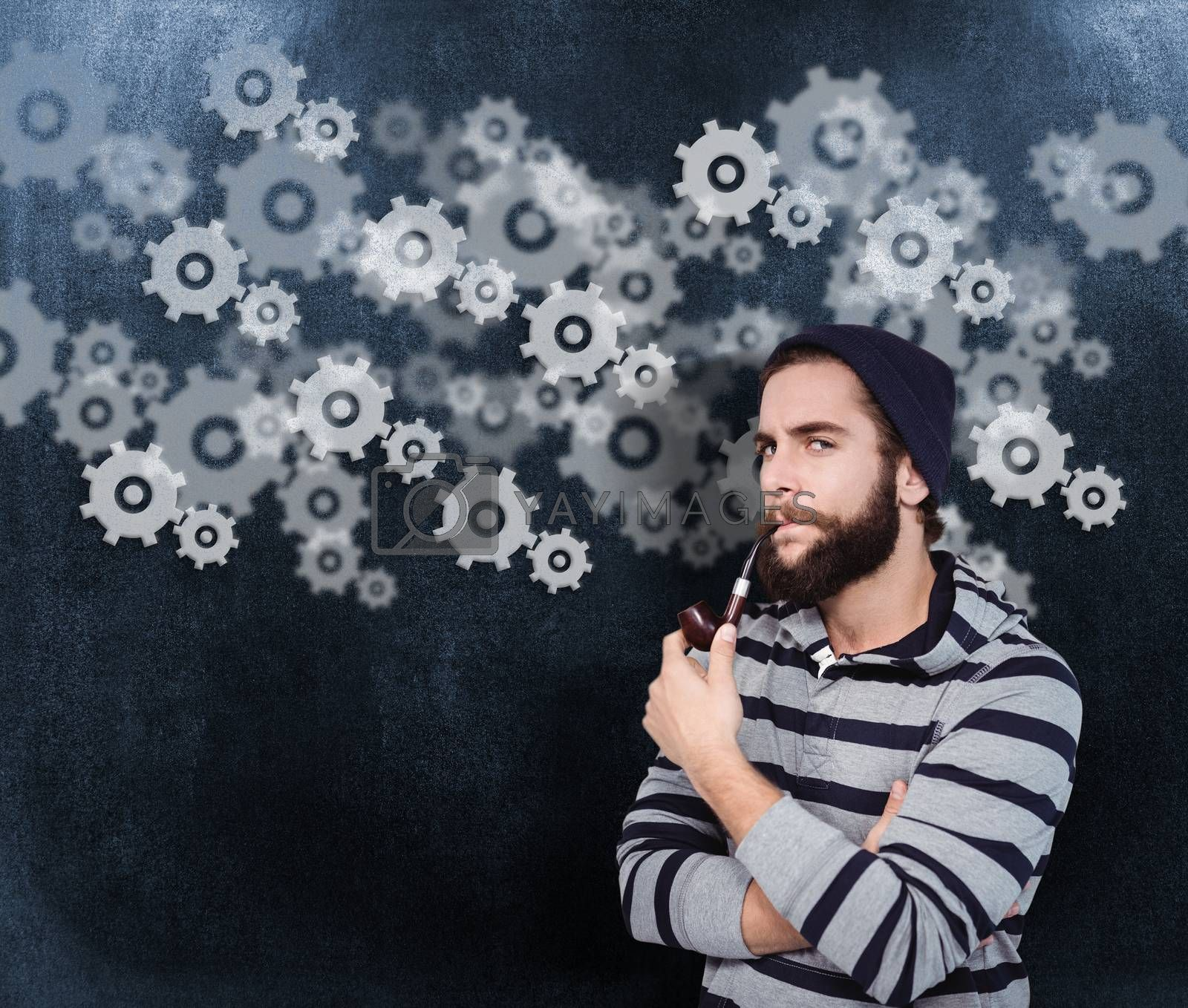 Portrait of serious hipster smoking pipe against black background