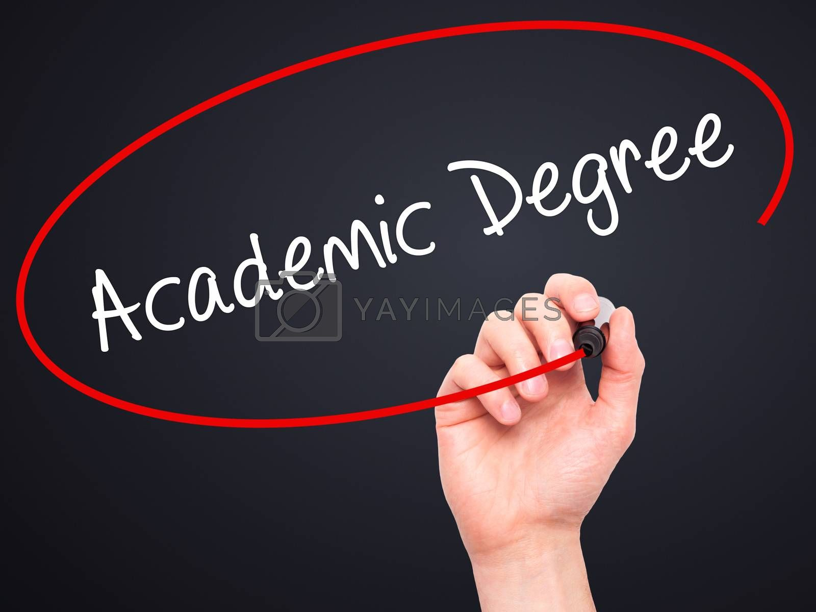 Man Hand writing Academic Degree with black marker on visual screen. Isolated on black. Business, technology, internet concept. Stock Photo