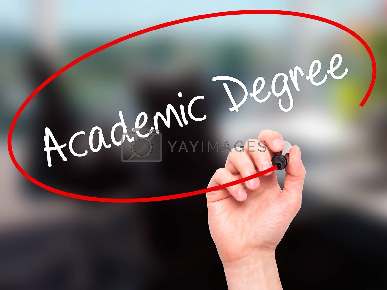 Man Hand writing Academic Degree with black marker on visual screen. Isolated on office. Business, technology, internet concept. Stock Photo