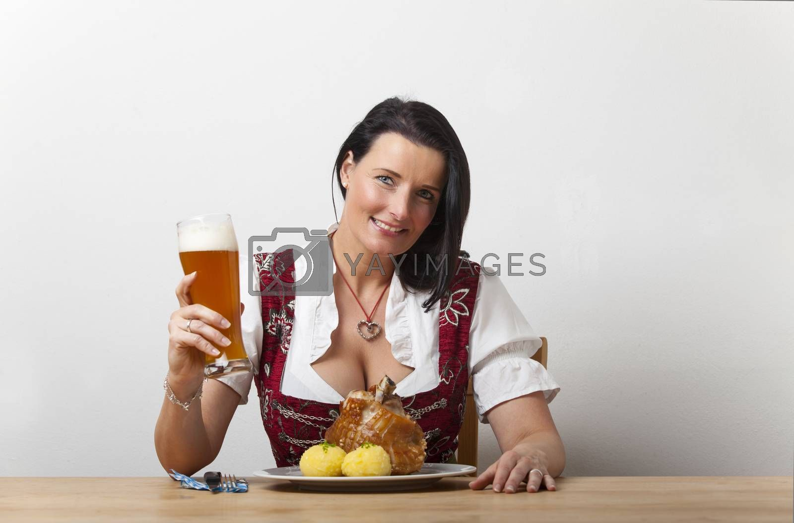 bavarian woman with roasted knuckle of pork