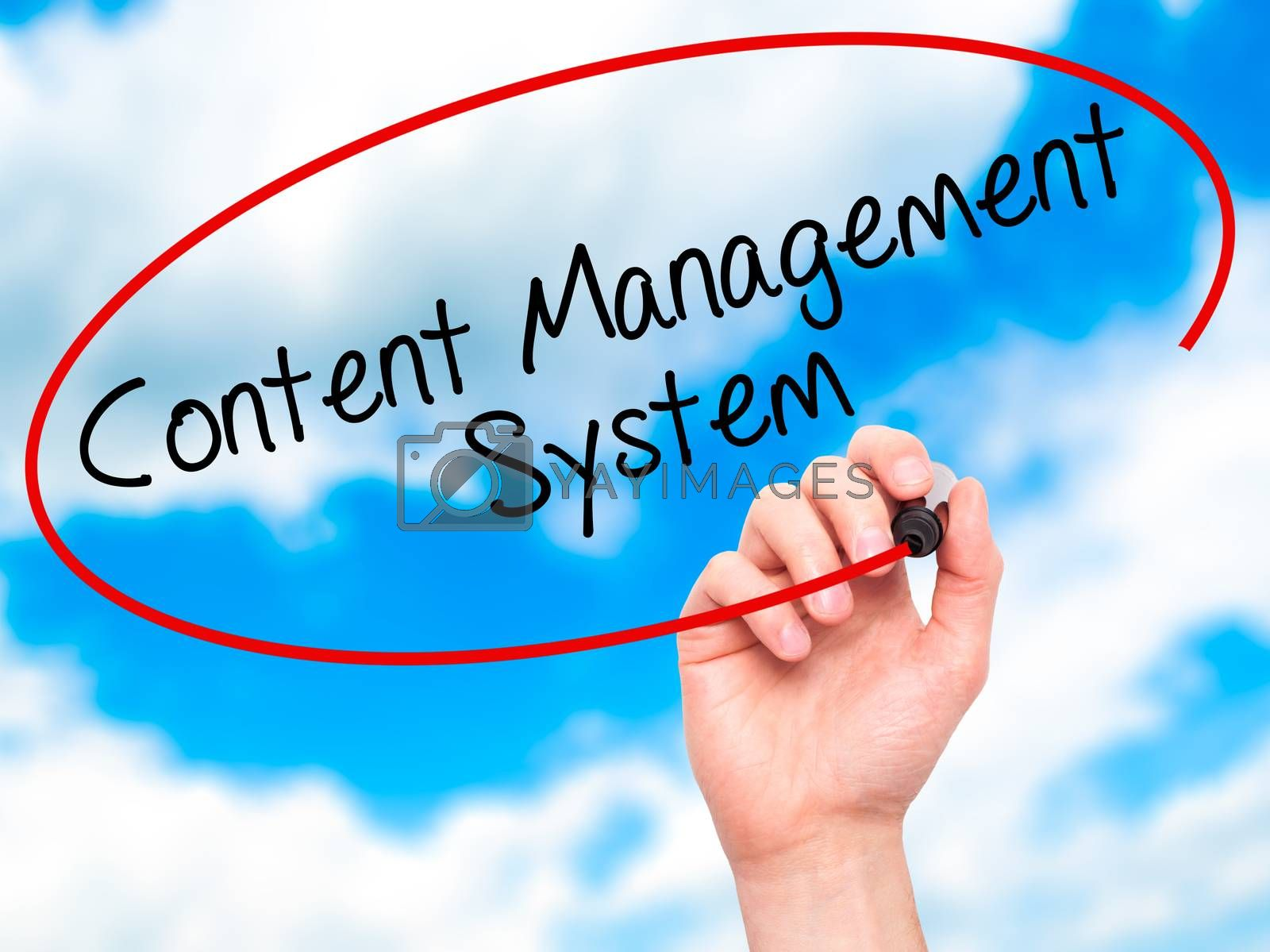 Man Hand writing Content Management System  with black marker on visual screen. Isolated on sky. Business, technology, internet concept. Stock Photo