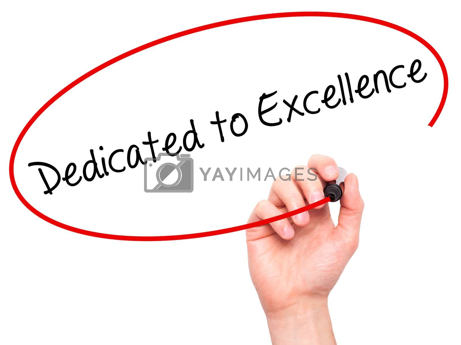 Man Hand writing Dedicated to Excellence  with black marker on visual screen. Isolated on white. Business, technology, internet concept.