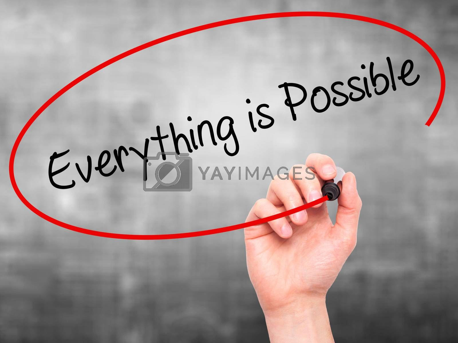 Man Hand writing Everything is Possible with black marker on visual screen. Isolated on grey. Business, technology, internet concept. Stock Photo