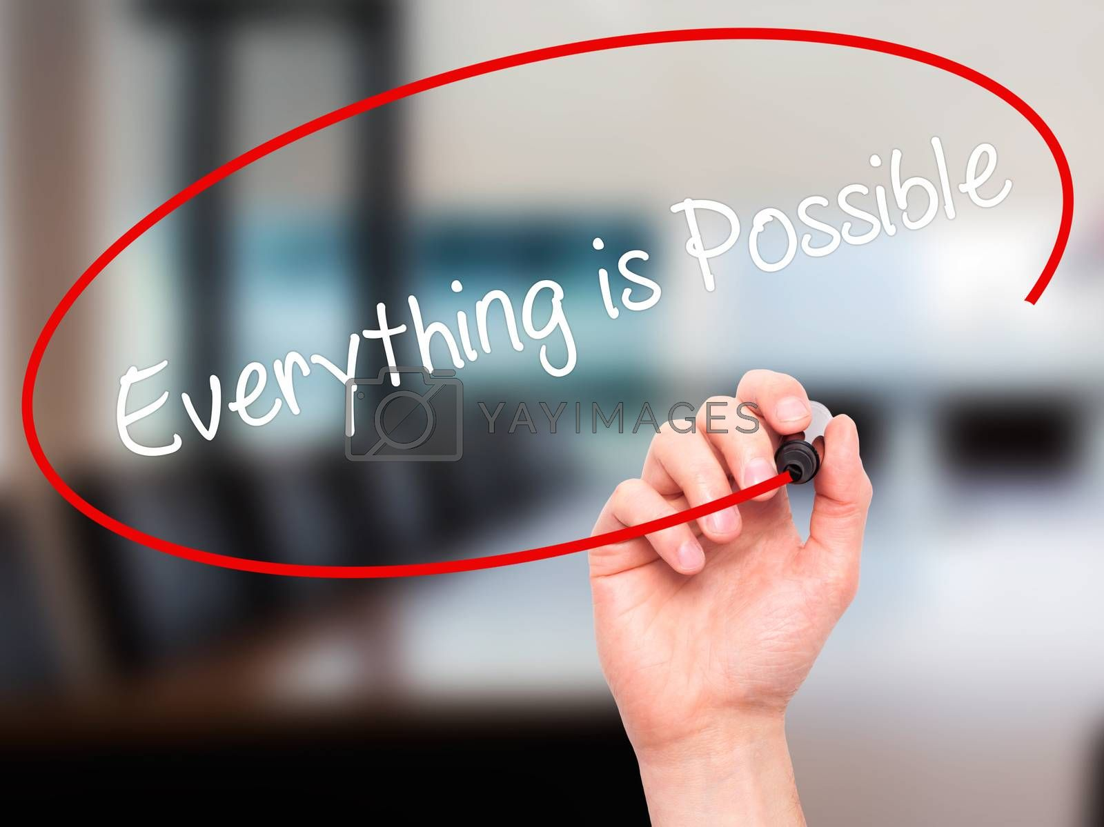 Man Hand writing Everything is Possible with black marker on visual screen. Isolated on office. Business, technology, internet concept. Stock Photo