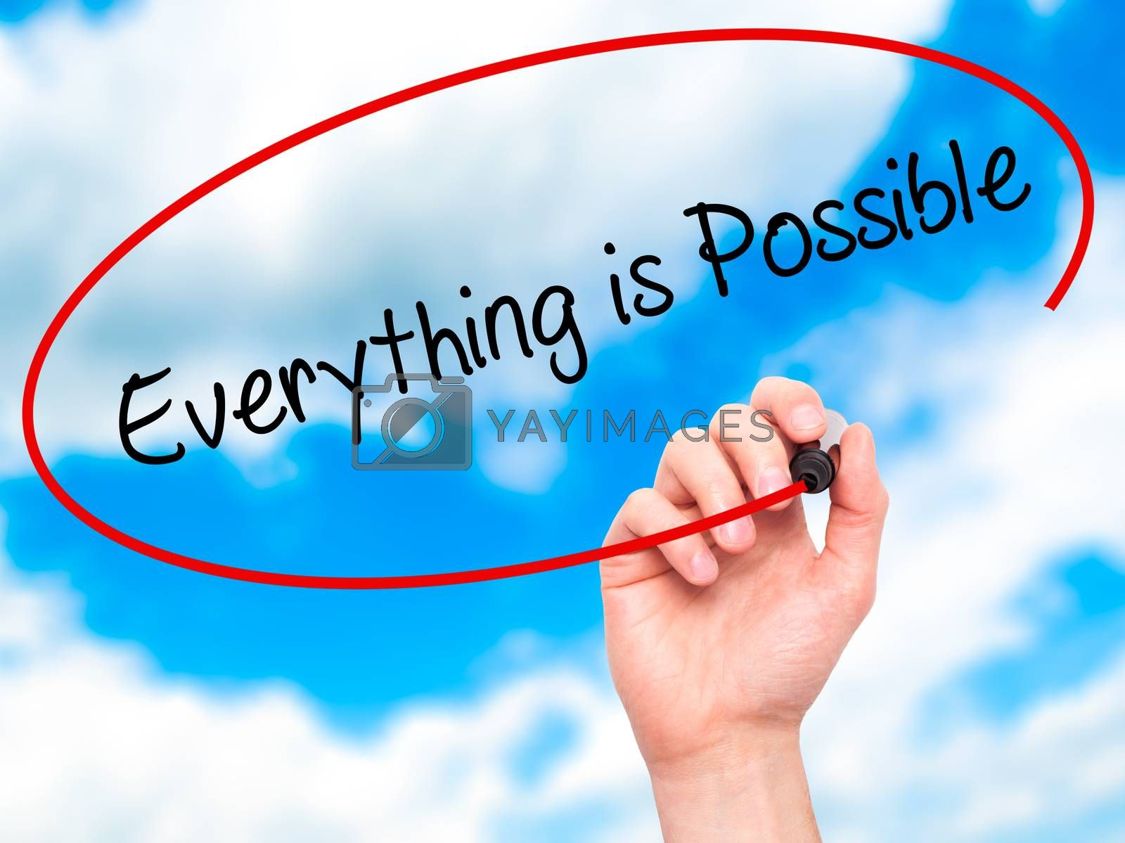 Man Hand writing Everything is Possible with black marker on visual screen. Isolated on sky. Business, technology, internet concept. Stock Photo