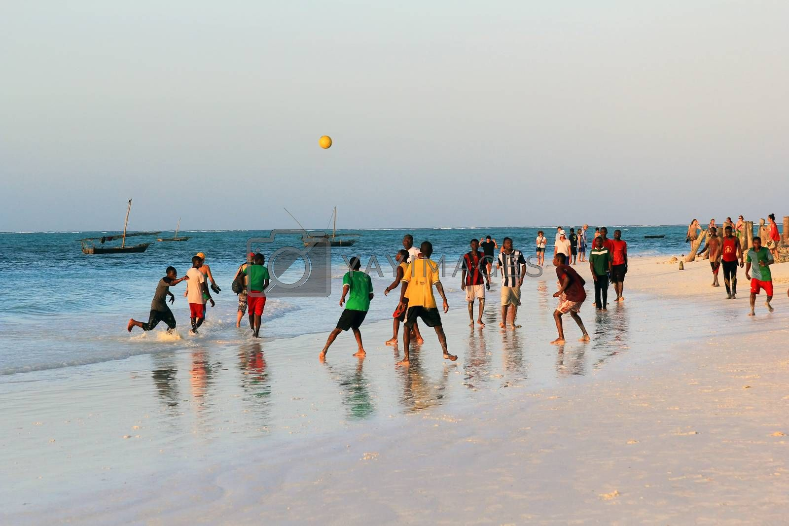 Zanzibar, Tanzania - January 4, 2016: A game of football on the beach at sunset in Nungwi. Zanzibar, Tanzania