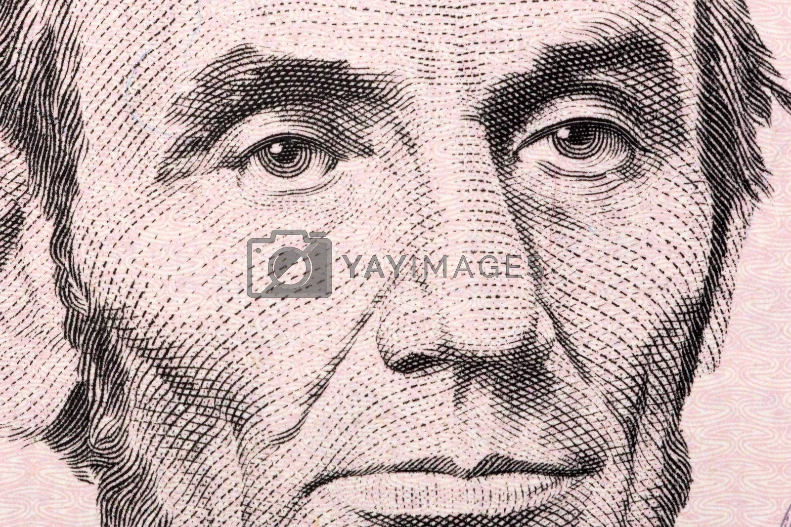 Abraham Lincoln a close-up portrait on US five dollars