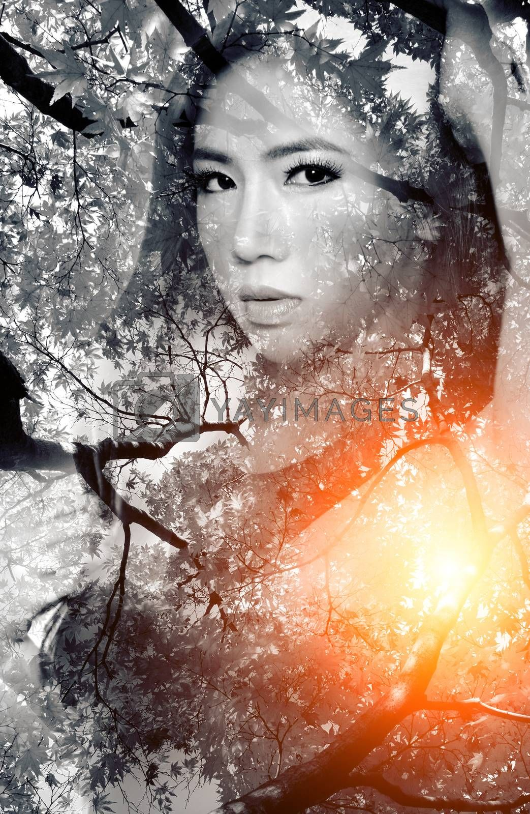 Double exposure portrait of Beautiful girl combined with photograph of nature.