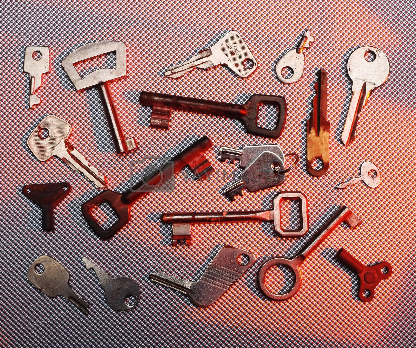 some different vintage keys close up, in color spot
