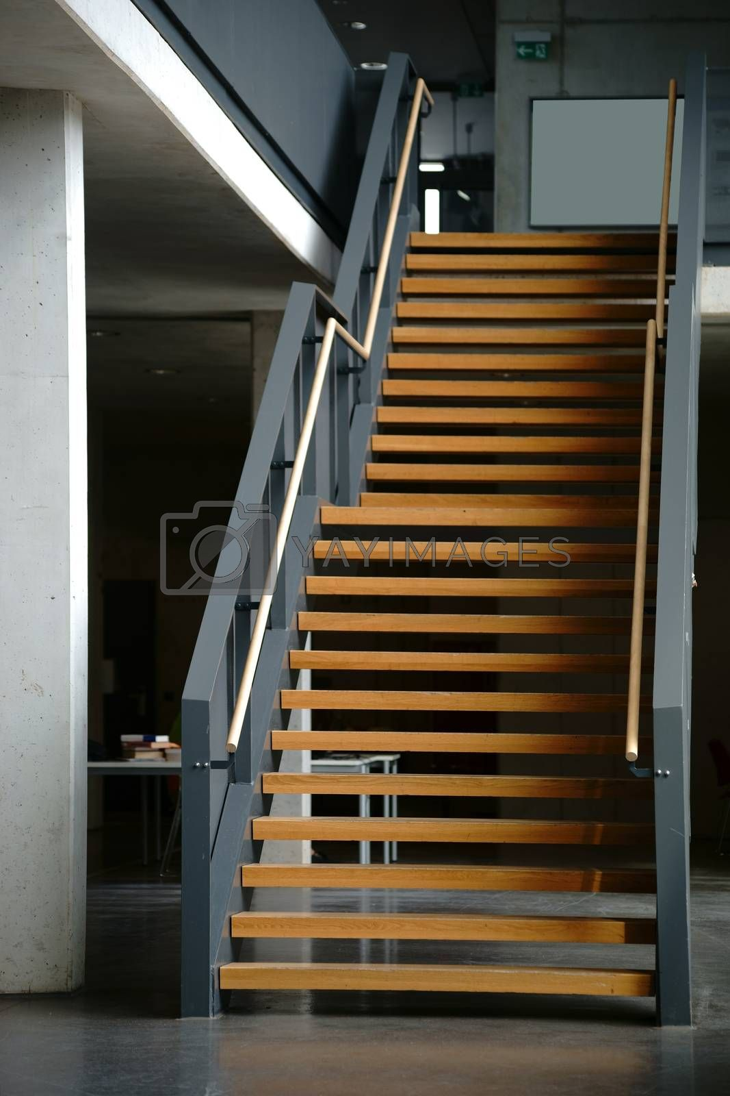 A staircase in a school building from the ground floor to the first floor.