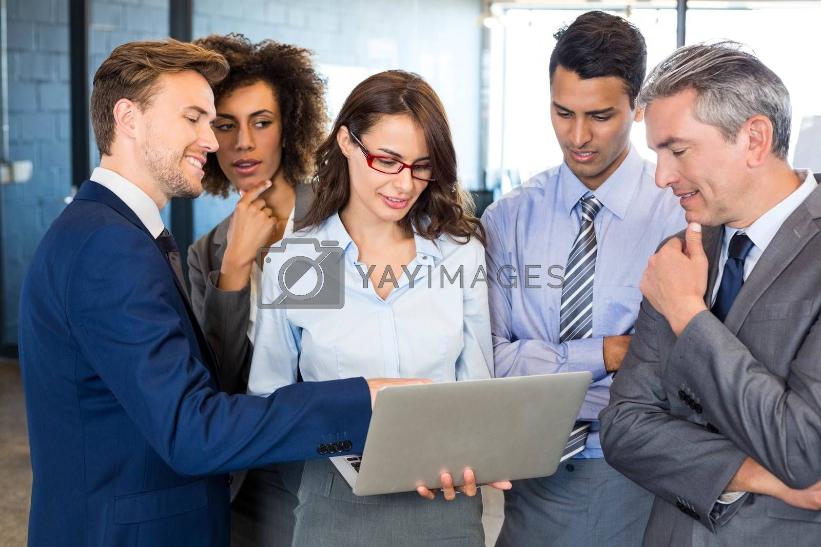 Business team standing together and interacting in office