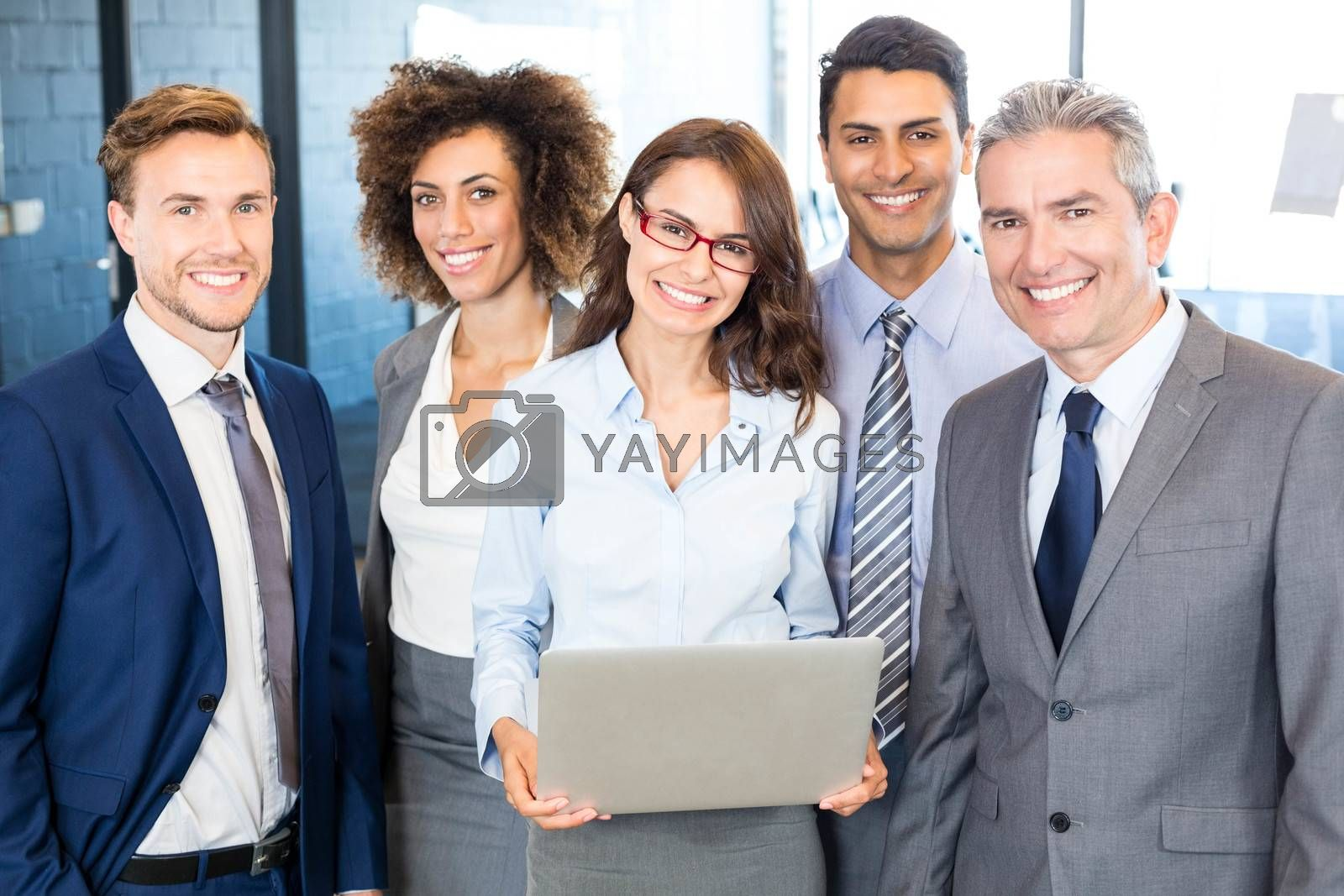 Portrait of happy business team standing in office
