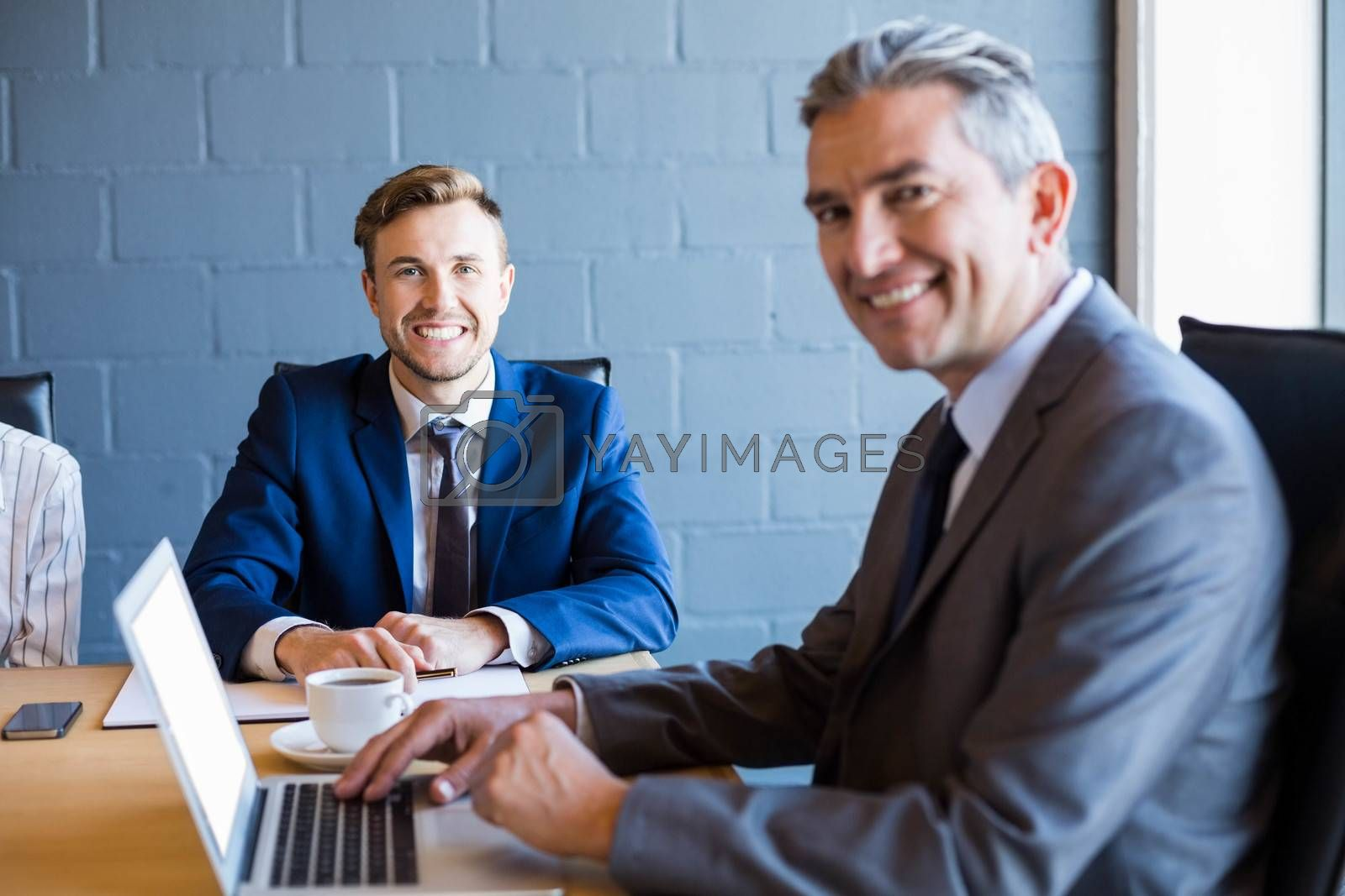Businessman working on laptop in a conference room during meeting at office