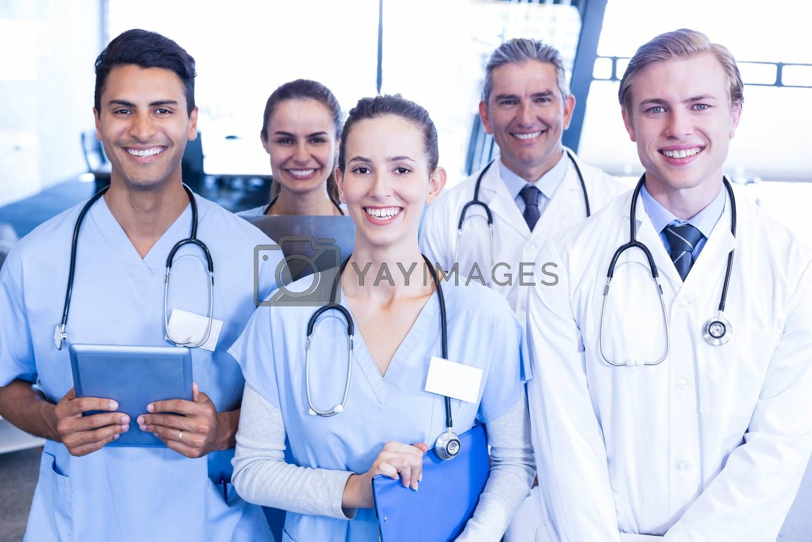 Portrait of medical team standing together and smiling in hospital