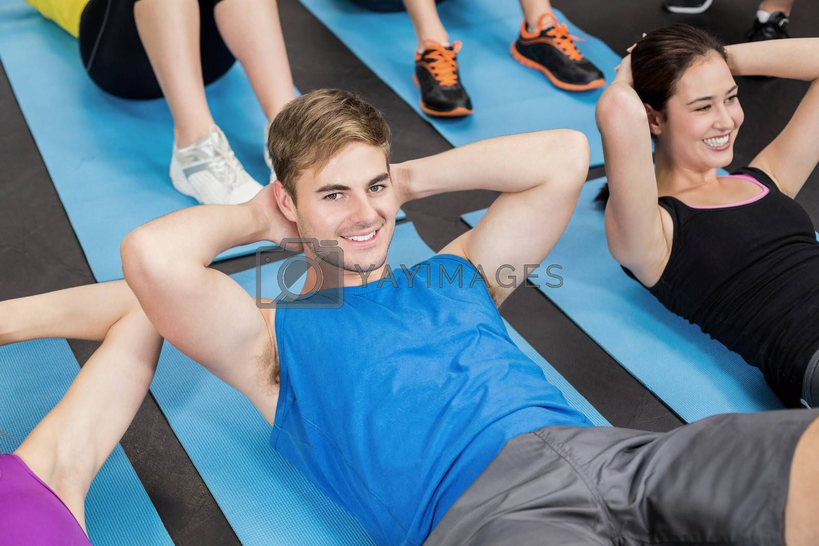 Group of people working their abs in gym