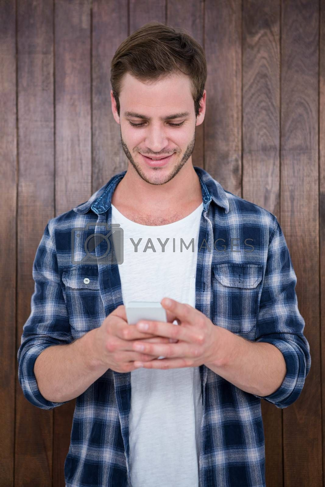 Handsome hipster looking at selfie on wooden background