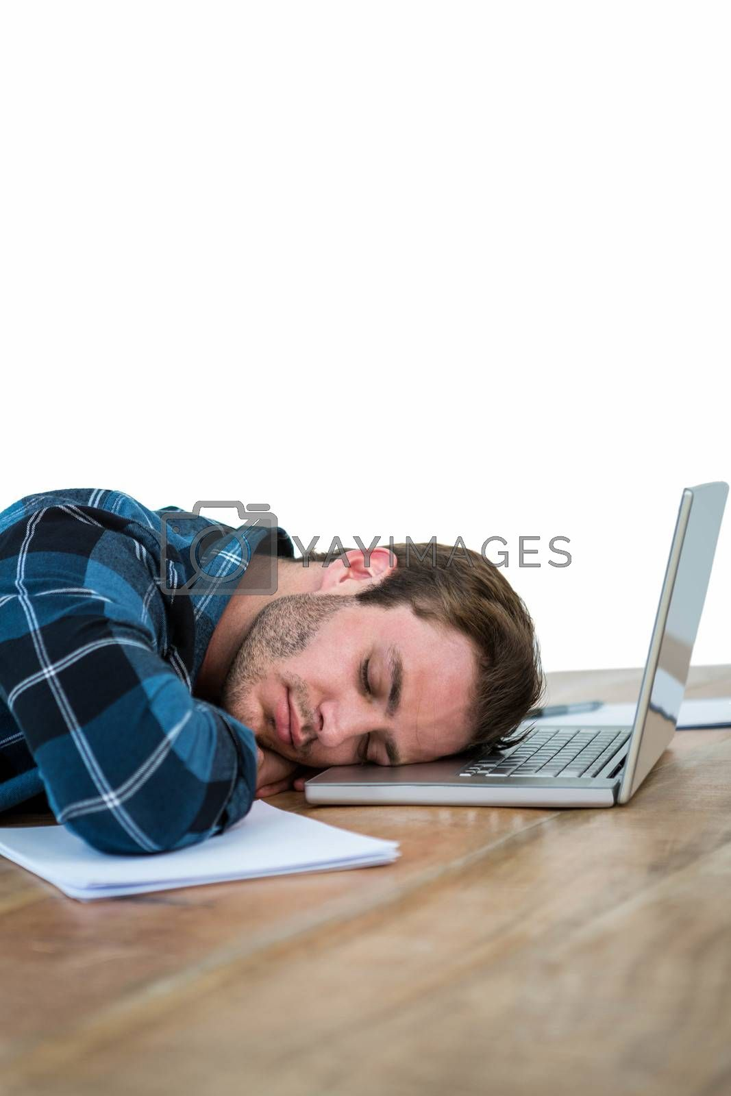 Handsome man sleeping on laptop in a bright office