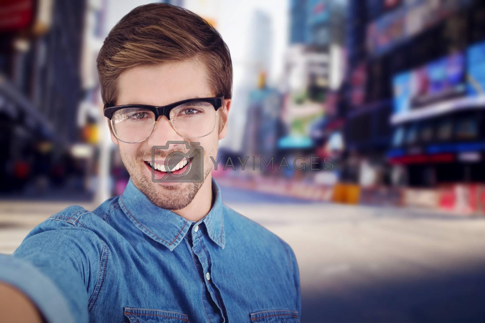 Portrait of happy man wearing eye glasses against blurry new york street