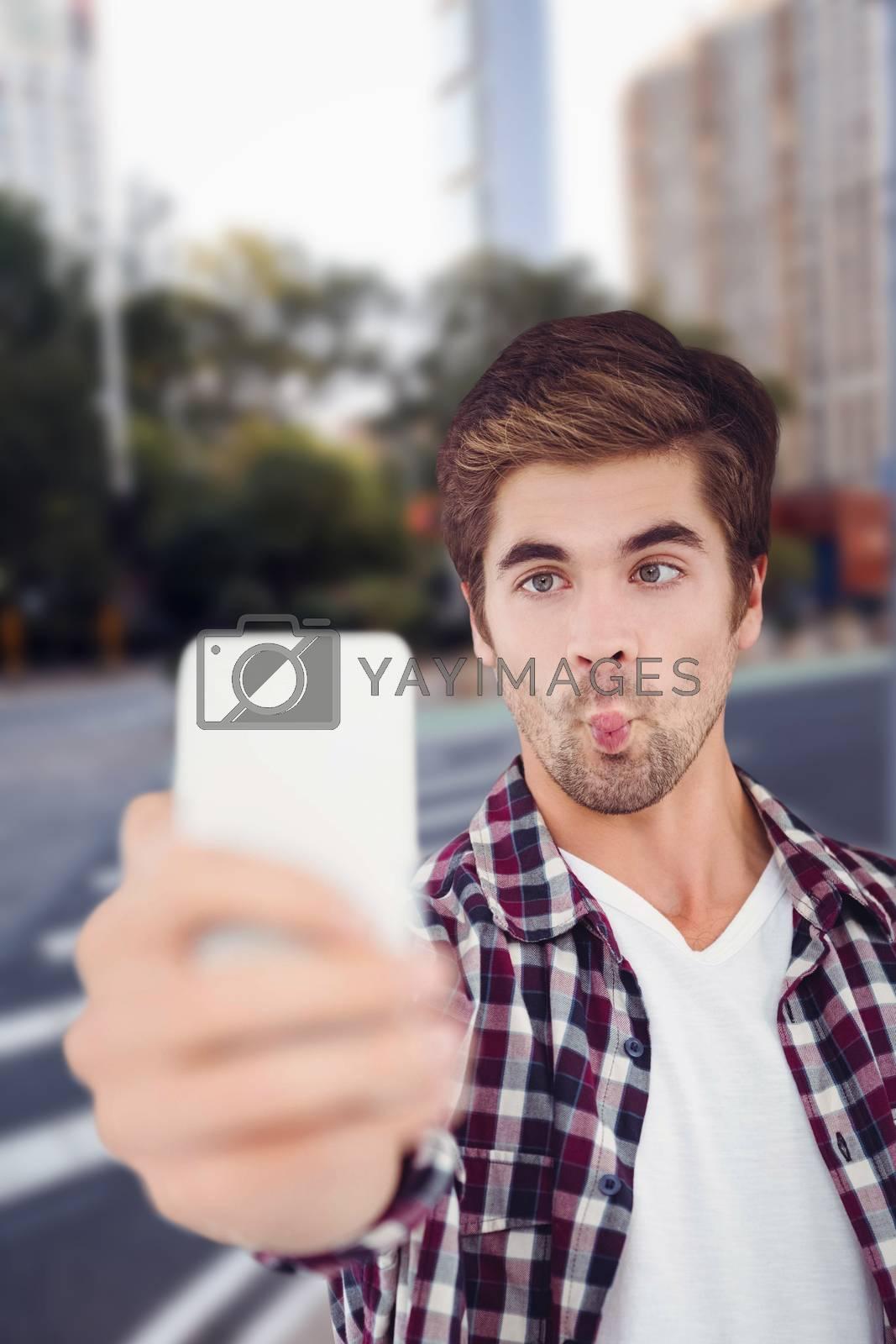 Man making face while taking selfie against new york street