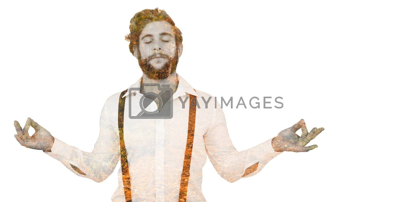 Hipster meditating arms outstretched against autumn scene