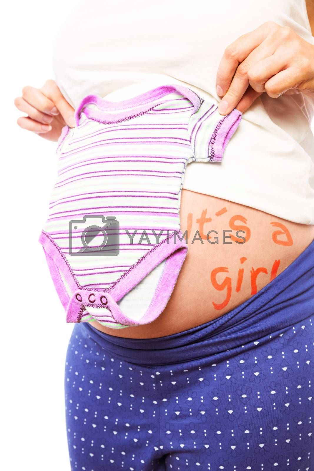 Pregnant woman holding pink pyjamas over her belly