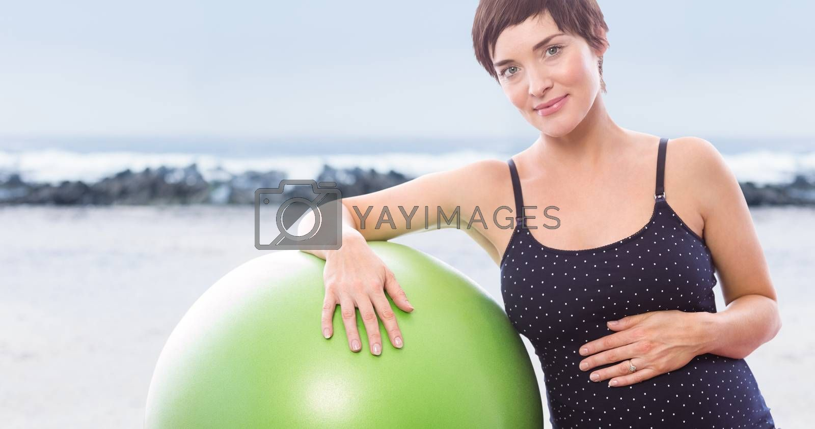 Happy pregnant woman with exercise ball over white background against view of waves