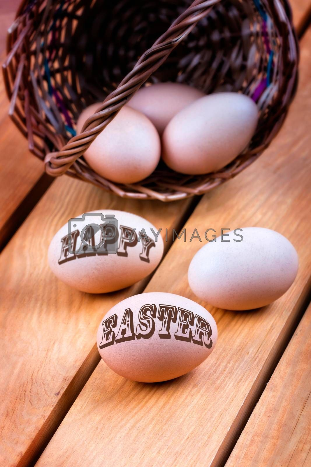 Happy easter - eggs in a basket on a wooden background