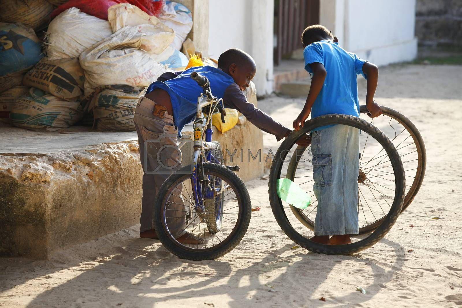 Zanzibar, Tanzania - January 8, 2016: two unknown African boy playing in the street in the village of Jambiani, Zanzibar. Tanzania