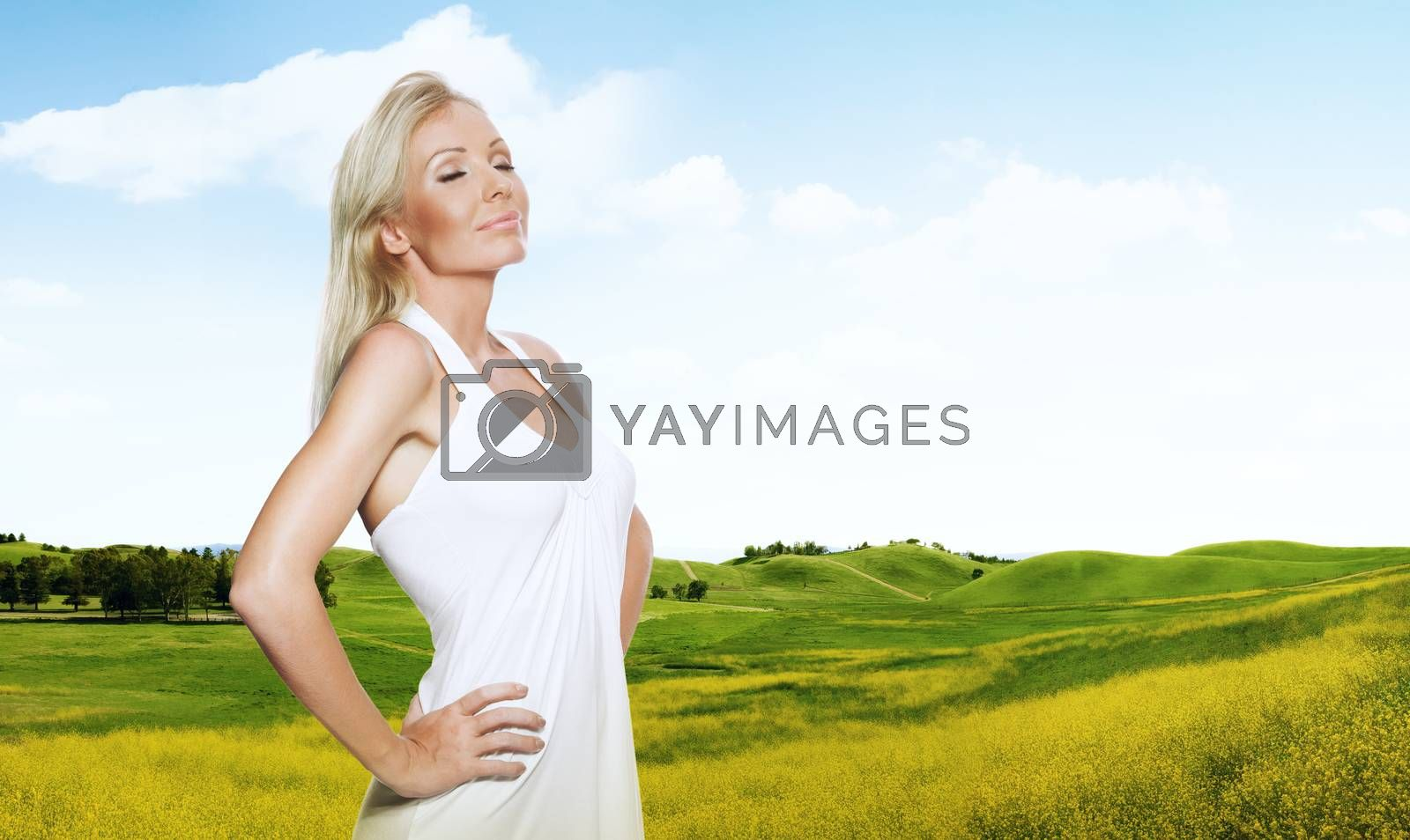 portrait of young beautiful woman in summer environment