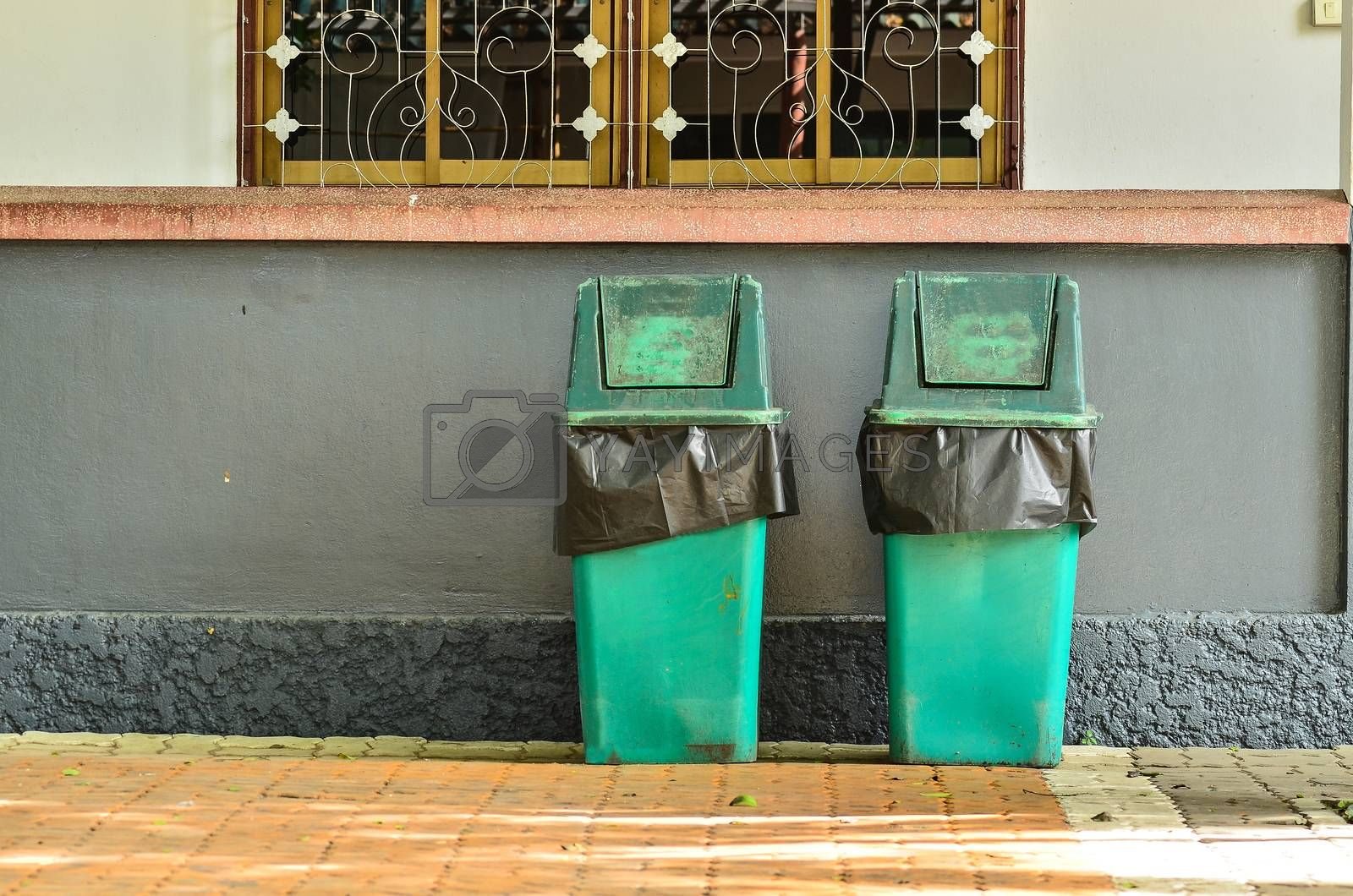 Royalty free image of Green trashcan for keeping garbage  by raweenuttapong
