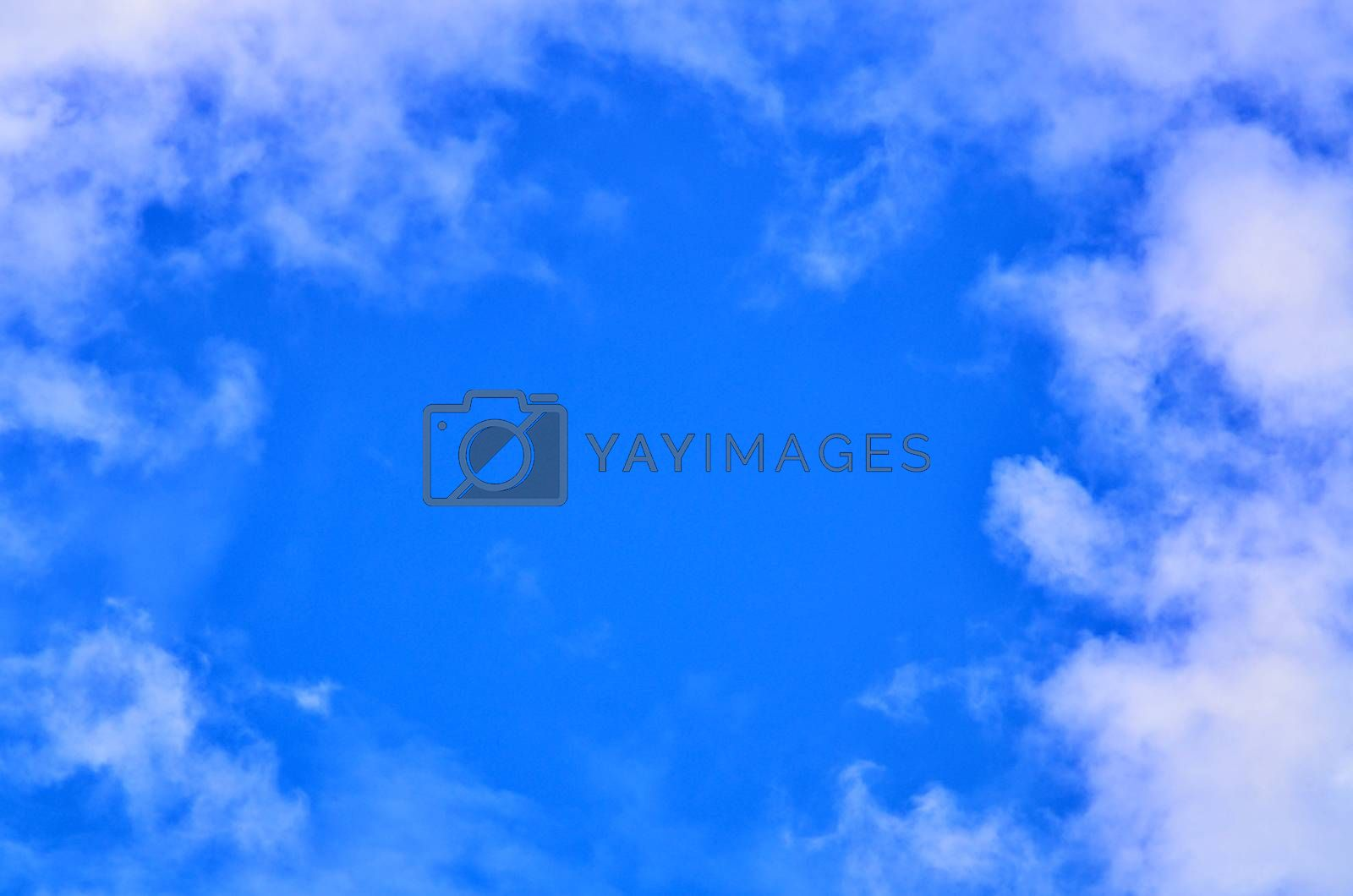 Royalty free image of clouds in the blue sky by raweenuttapong