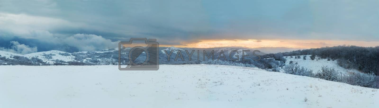 Winter landscape- panorama of winter mountains and icy forest.